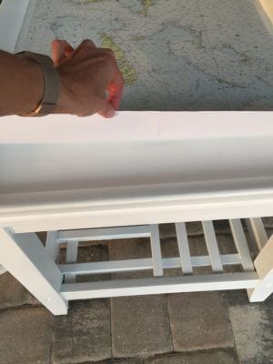 End Table Coastal Makeover - Flip the paper up to spray with adhesive, a little at a time