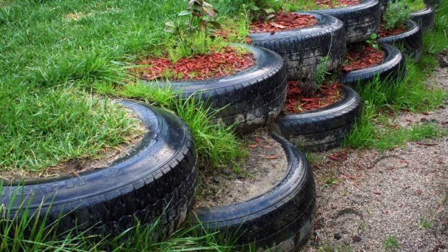 Recycle your old tires in your retaining wall
