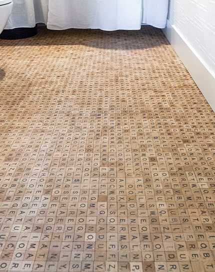 This Scrabble Wood Tile Floor is the Ultimate Bathroom Reader