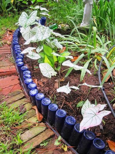 Make a sparkly wine bottle garden edging