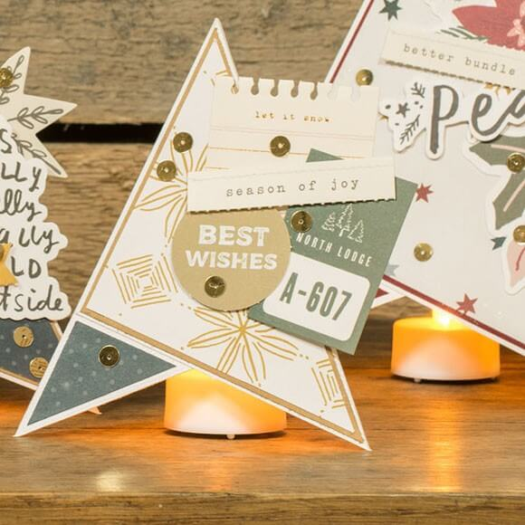 Place an LED tea light under the paper Christmas trees.