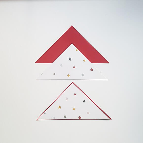 Stick the scrapbook paper triangles onto the cardstock triangles. Pay attention to the direction of the pattern!