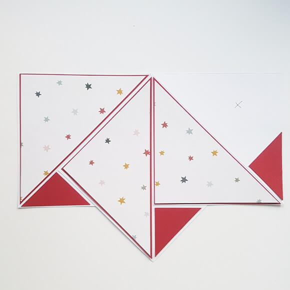 Now, make 2 squares measuring 5.5cm from cardstock and cut through them diagonally, then stick them onto the plain card. You will only need 3 triangles.
