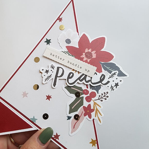 Decorate the card to your liking with a selection of embellishments.