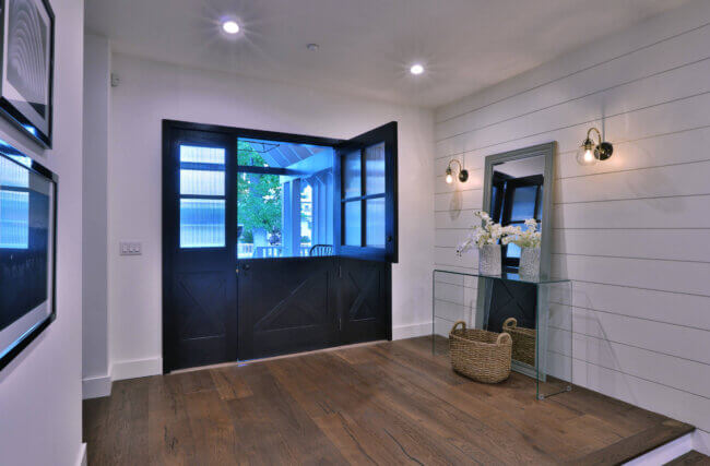 Country Medium Tone Wood Floor Entryway Idea With White Walls And A Black Front Door