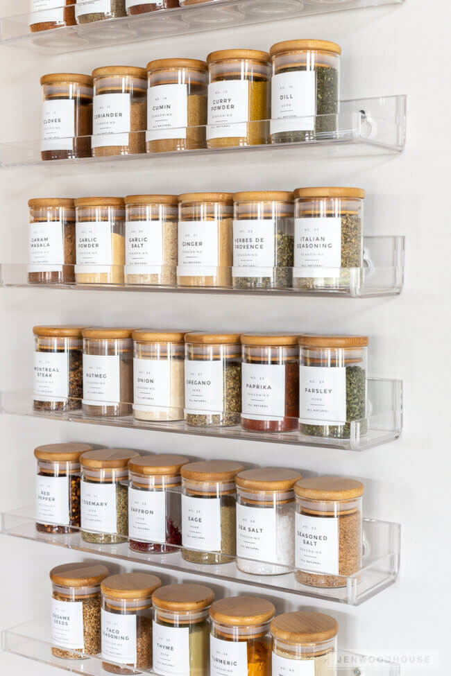 Beautiful And Functional Spice Rack Organization Featuring Glass Jars And Custom Labels
