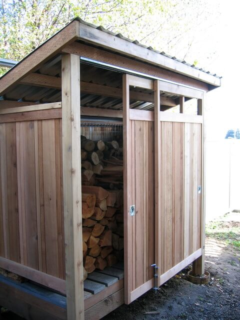 Firewood shed built with reclaimed materials